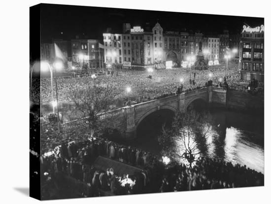 People Celebrating the Independence of Ireland on O'Connell Bridge before Midnight on Easter Sunday-Larry Burrows-Stretched Canvas Print
