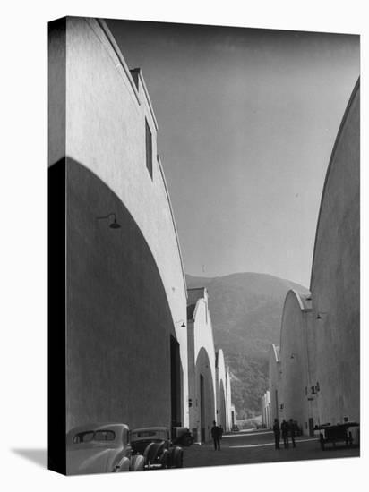 People Walking Between Sound Stages at Warner Bros. Studio-Margaret Bourke-White-Stretched Canvas Print