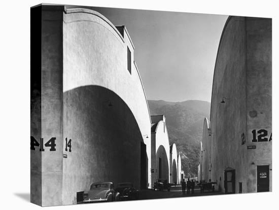 People Walking Between Sound Stages at Warner Brothers Studio-Margaret Bourke-White-Stretched Canvas Print