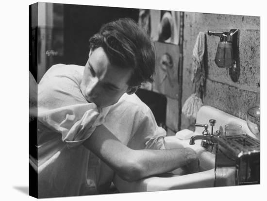 Pianist Glenn Gould Soaking His Hands in Sink to Limber Up His Fingers Before in Studio-Gordon Parks-Stretched Canvas Print