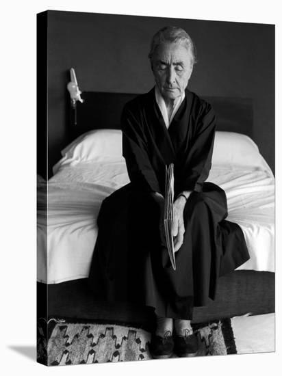 Portrait of Artist Georgia O'Keeffe Holding a Book by Leonard Baskinin Her Bedroom-John Loengard-Stretched Canvas Print