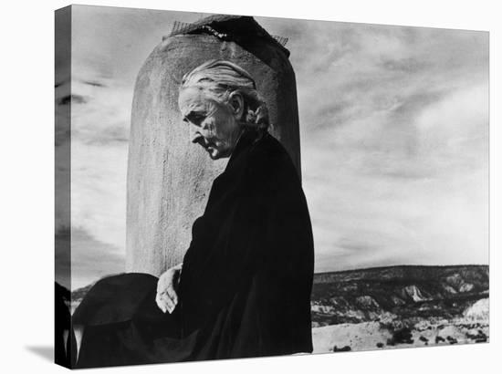 Portrait of Artist Georgia O'Keeffe Sitting on the Roof of Her Ghost Ranch Home-John Loengard-Stretched Canvas Print