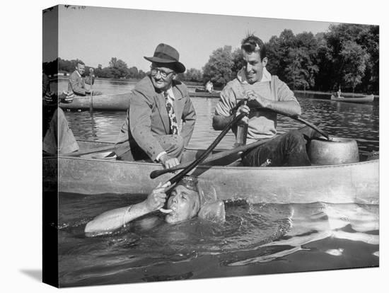 Princeton University Student George Montgomery Drinking Beer from a Hose--Stretched Canvas Print