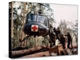 """American 4th Battalion  173rd Airborne Brigade Soldiers Loading Wounded Onto a """"Huey"""" Helicopter"""