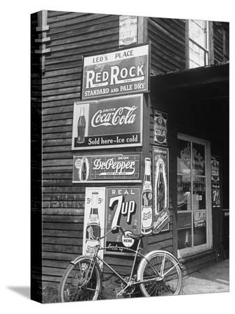 alfred-eisenstaedt-food-store-called-leo-s-place-covered-with-beverage-ads-incl-coca-cola-7-up-dr-pepper-and-pepsi
