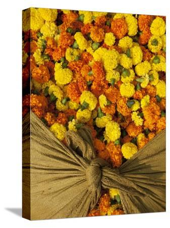 april-maciborka-single-marigolds-of-yellow-and-orange-are-sold-by-bagful-to-local-worshippers