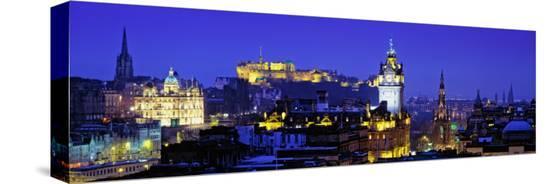 buildings-lit-up-at-night-with-a-castle-in-the-background-edinburgh-castle-edinburgh-scotland