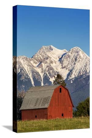 chuck-haney-red-barn-sits-below-mcdonald-peak-in-the-mission-valley-montana-usa
