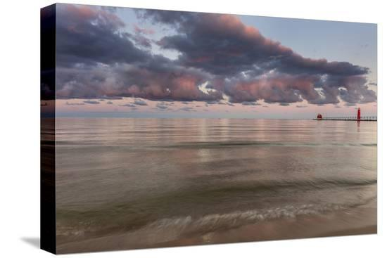 chuck-haney-sunrise-clouds-over-lake-michigan-and-the-grand-haven-lighthouse-in-grand-haven-michigan-usa