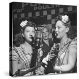 Sisters Performing at the Microphone at the Grand Ole Opry