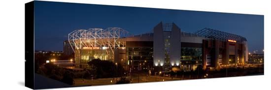football-stadium-lit-up-at-night-old-trafford-greater-manchester-england