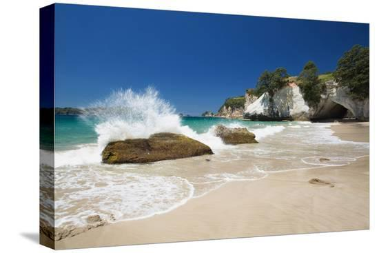 garry-ridsdale-waves-splashing-against-large-rocks-on-the-beach-in-cathedral-cove-coromandel-waikato