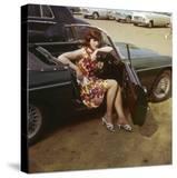 "Girl in a Classic Racing Green ""MGB"" Sports Car"