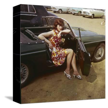 girl-in-a-classic-racing-green-mgb-sports-car