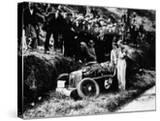 Goldie Gardner by the Wreckage of an Mg J4  1932