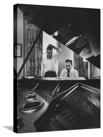 gordon-parks-authors-of-my-fair-lady-allan-jay-lerner-and-frederick-loewe-at-piano-working-on-music