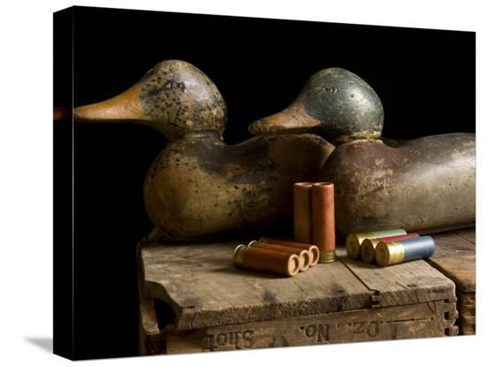 joel-sartore-antique-duck-decoys-and-shotgun-shells-sit-on-an-old-wooden-crate
