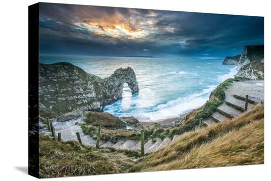 john-alexander-a-winter-sunset-at-durdle-door-on-the-jurassic-coast-dorset-england-united-kingdom-europe