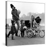 Jenny Boyd in Light Pants and Boots with Children  1960s