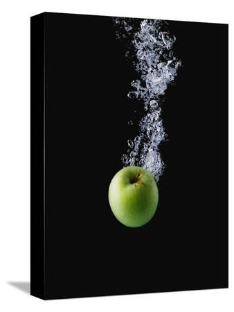 john-smith-green-apple-in-water