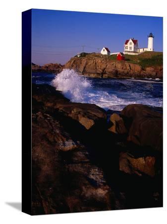 levesque-kevin-surf-crashing-on-york-beach-with-nubble-lighthouse-in-background-cape-neddick-usa