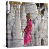 Myanmar  Burma  Lake Inle  A Young Novitiate Passes an Ornate Buddhist Shrine