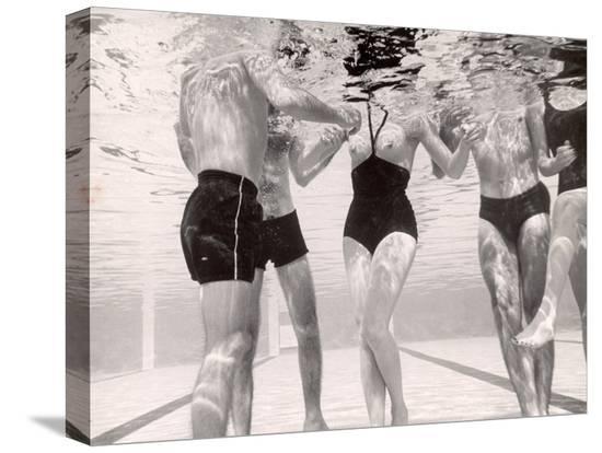 paul-schutzer-underwater-shot-of-actress-daphne-dayle-in-topless-one-piece-swim-suit-by-designer-ruben-torres