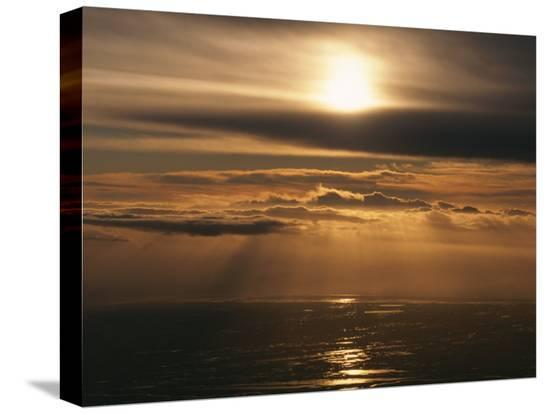 peter-carsten-sunset-and-clouds-over-the-ocean