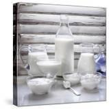 Various Dairy Products in Front of Window Frame