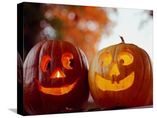 stephen-st-john-a-cheerful-pair-of-jack-o-lanterns-against-a-background-of-fall-foliage