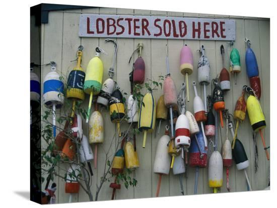 stephen-st-john-colorful-lobster-buoys-hang-on-a-new-england-shed