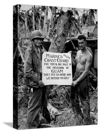 stocktrek-images-the-u-s-marines-salute-the-u-s-coast-guard-after-teh-battle-for-guam