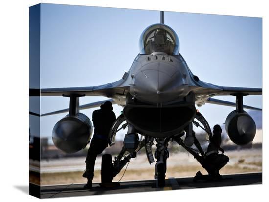 stocktrek-images-u-s-air-force-crew-chiefs-do-pre-flight-checks-under-an-f-16-fighting-falcon