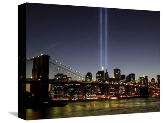 the-tribute-of-light-memorial-shines-into-the-sky-over-the-night-skyline-of-new-york-city
