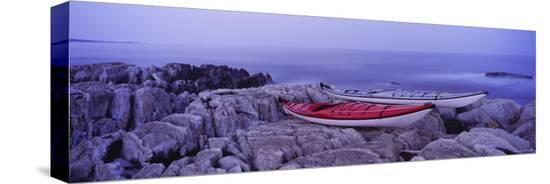 two-kayaks-on-a-cliff-cherry-hill-nova-scotia-canada