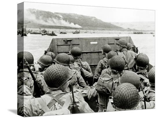u-s-soldiers-watch-the-normandy-coast-from-a-landing-craft-vehicle-personnel