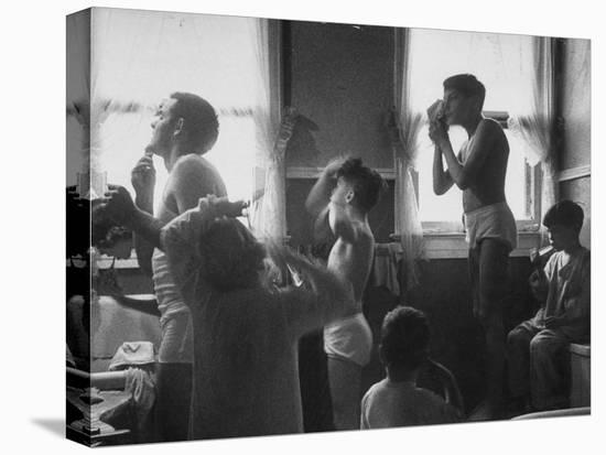 Professional Couple's Big Family, Sharing the Only Bathroom, Early in the Morning-Gordon Parks-Stretched Canvas Print