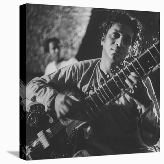 Ravi Shankar Passionately Playing the Sitar-Paul Schutzer-Stretched Canvas Print