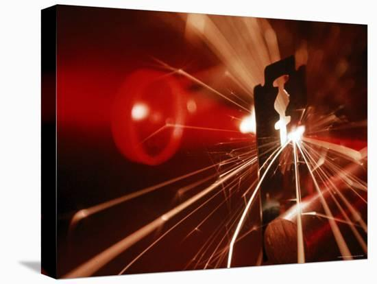 Red Laser Light Focused Through Lens Blasts Pin Point Hole Through Razor in Thousandth of a Second-Fritz Goro-Stretched Canvas Print