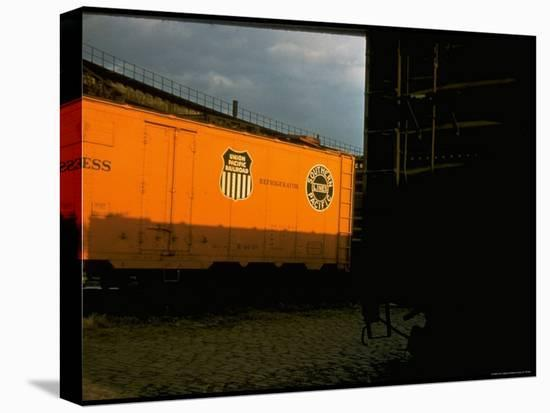 Refrigerated Box Car with the Union Pacific Railroad Logo and Southern Pacific Line-Walker Evans-Stretched Canvas Print