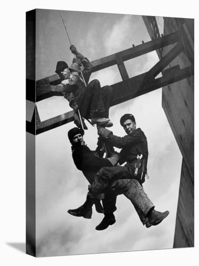 Relief Workers Hanging from Cable in Front of a Giant Beam During the Construction of Fort Peck Dam-Margaret Bourke-White-Stretched Canvas Print