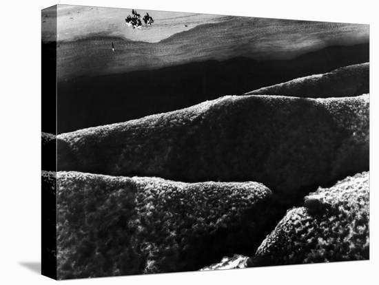 Riders Guiding their Horses Along the Shore as Mountainous Waves of High Tide Roll Shoreward-Margaret Bourke-White-Stretched Canvas Print