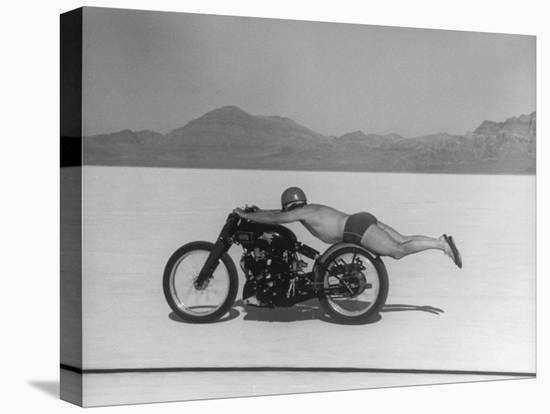 Roland Free Breaking World's Speed Record on Bonneville Salt Flats While Laying on His Bike-Peter Stackpole-Stretched Canvas Print