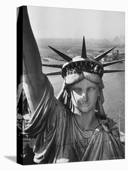 Sightseers Hanging Out Windows in Crown of Statue of Liberty with NJ Shore in the Background-Margaret Bourke-White-Stretched Canvas Print