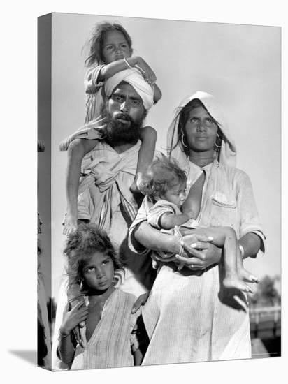 Sikh and His Family in Convoy Migrating to East Punjab After the Division of India-Margaret Bourke-White-Stretched Canvas Print