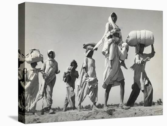 Sikh Carrying His Wife on Shoulders After the Creation of Sikh and Hindu Section of Punjab India-Margaret Bourke-White-Stretched Canvas Print