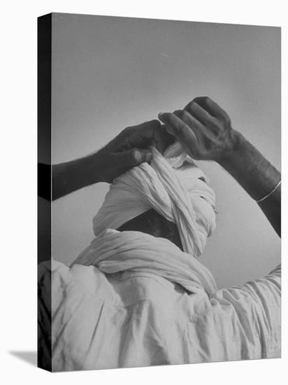 Sikh Man Demonstrating How He Finishes the Winding of His Traditional Turban around His Head-Margaret Bourke-White-Stretched Canvas Print