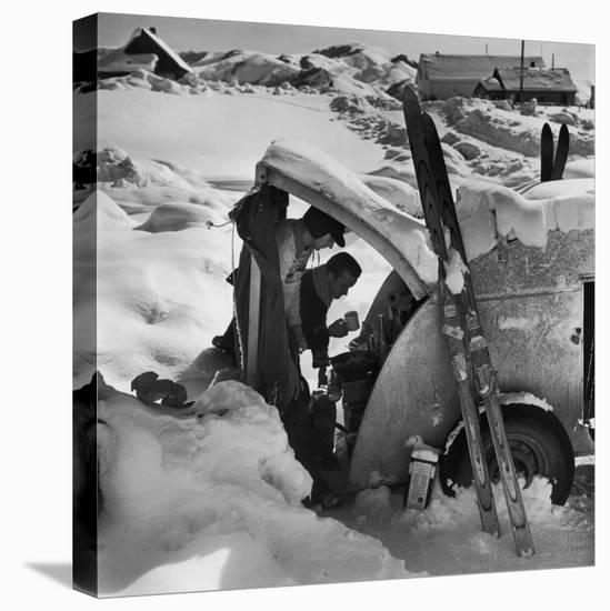 Ski Bum Bob Lombard Pouring Coffee from the Back of His Trailer-Loomis Dean-Stretched Canvas Print