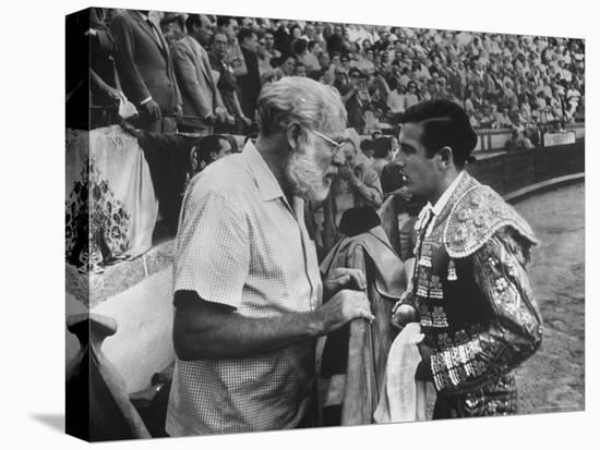 Spanish Matador Antonio Ordonez with Friend, Author Ernest Hemingway in Arena Before Bullfight-Loomis Dean-Stretched Canvas Print