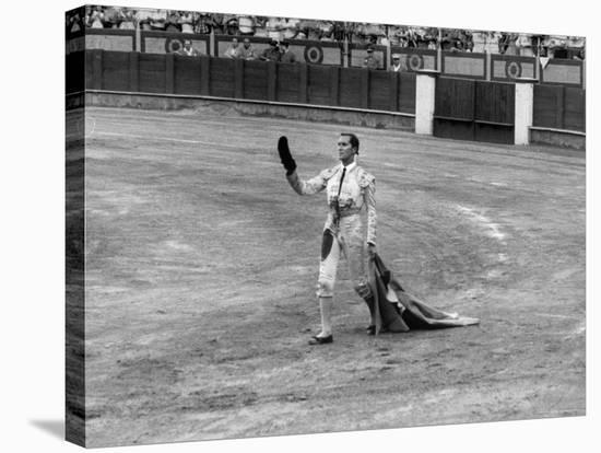Spanish Matador Luis Miguel Dominguin Doffing His Cap as He Acknowledges the Applause of the Crown-Loomis Dean-Stretched Canvas Print